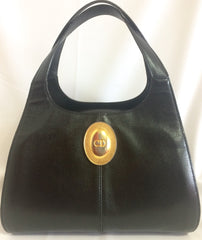 Vintage Christian Dior grained black leather handbag with oval golden CD logo. Classic style but rare design. Daily use.