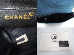 Vintage CHANEL denim bag with golden cc closure and vertical stitches. nicely faded indigo denim purse.