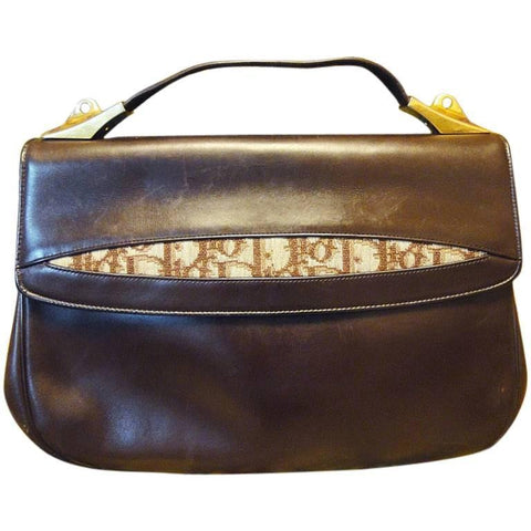 Vintage Christian Dior dark brown leather handbag with partial trotter jacquard on flap. Rare must have piece from old dior era.