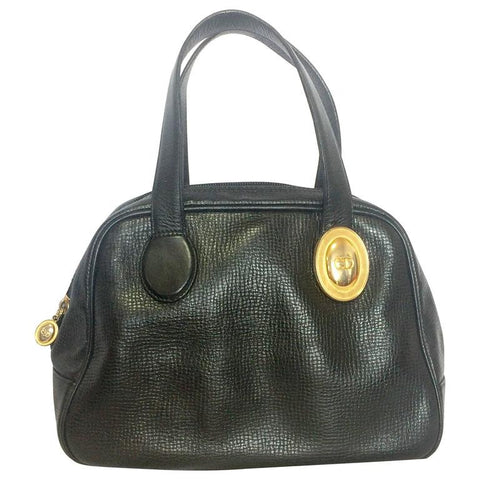 Vintage Christian Dior black grained leather mini bolide style handbag with oval golden CD logo motif. Classic style bag for daily use.
