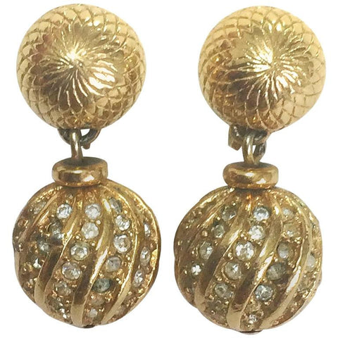 Vintage Christian Dior golden ball charm dangling earrings with rhinestone crystals.