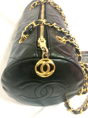 Vintage CHANEL black lamb leather golden chain shoulder bag in round drum shape with CC marks. Must have purse.