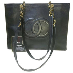Vintage CHANEL black caviarskin extra large tote bag with gold tone chain handles and CC motif. Classic purse for daily use