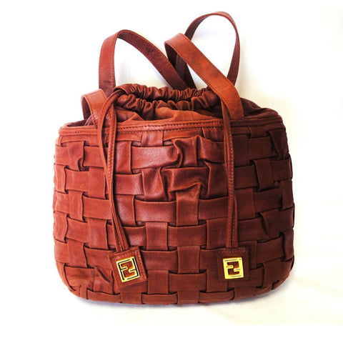 Vintage FENDI brick brown woven intrecciato, basket design hobo bucket shoulder bag with golden FF drawstrings. Rare masterpiece