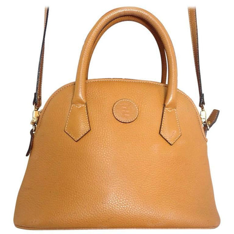 Vintage FENDI tanned brown leather oval shape, bolide style tote bag with a detachable shoulder strap and golden logo.