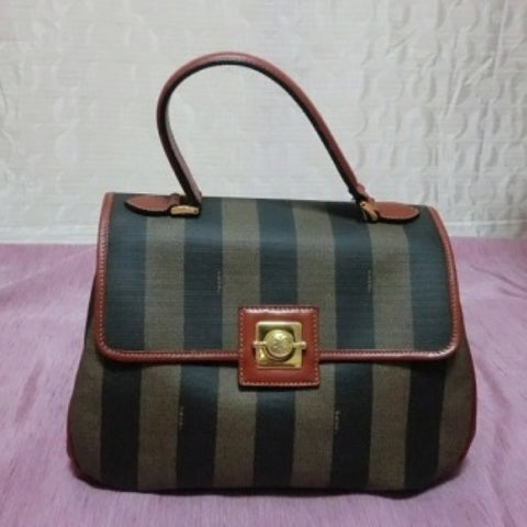 SOLD OUT: Vintage FENDI stripe purse with a metallic charms closure. Rare pecan stripe purse