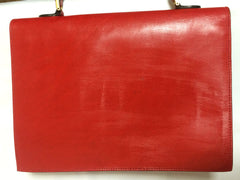 Vintage FENDI genuine red leather classic handbag with iconic Janus medallion embossed motif at front.