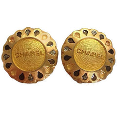 Vintage CHANEL gold tone teardrop petal motif flower shape logo earrings. Chic and mod vintage Chanel jewelry. Perfect gift