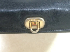Vintage FENDI genuine navy leather square and triangle shape handbag with embossed FF logo at front and closure on top. Rare masterpiece