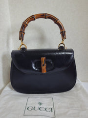 Vintage Gucci black genuine leather handbag with bamboo handle and red interior lining. Classic masterpiece from GUCCI.