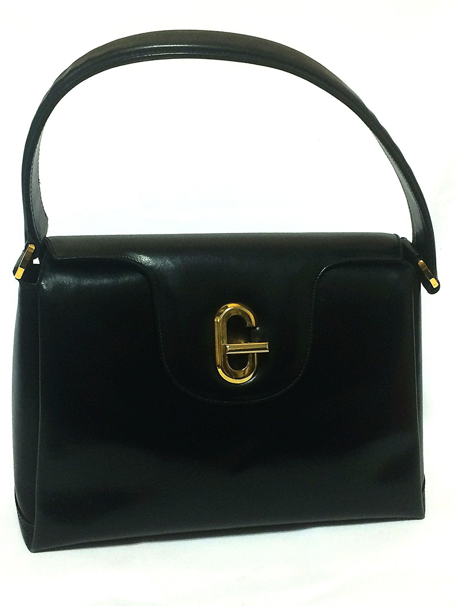 2eb67b0dcb9030 Vintage Gucci black leather classic design handbag purse with G hardware  turnlock closure and red interior