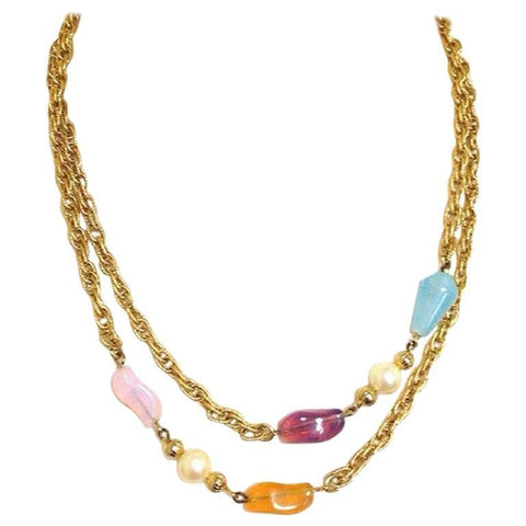 MINT. Vintage Givenchy, Paris, New York gold tone long chain necklace with purple, orange, pink, and blue motifs with 2 pearls. Can be double chain
