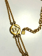 Vintage Givenchy three layer gold chain long necklace with rhinestone crystal logo charms. Statement necklace back in the era. Audrey