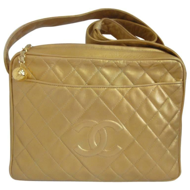 Vintage CHANEL Gold quilted lambskin large CC shoulder bag, camera purse style, with a gold tone CC ball charm. Best Chanel for daily use