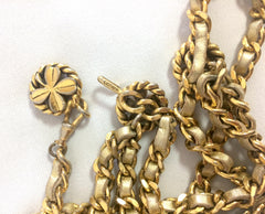 Vintage CHANEL gold leather chain and three-strand belt with golden clover and CC charms. Must-have belt from CHANEL. Also as necklace.