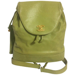 Vintage CHANEL green caviar leather backpack with gold chain strap and CC closure. Classic but rare color.