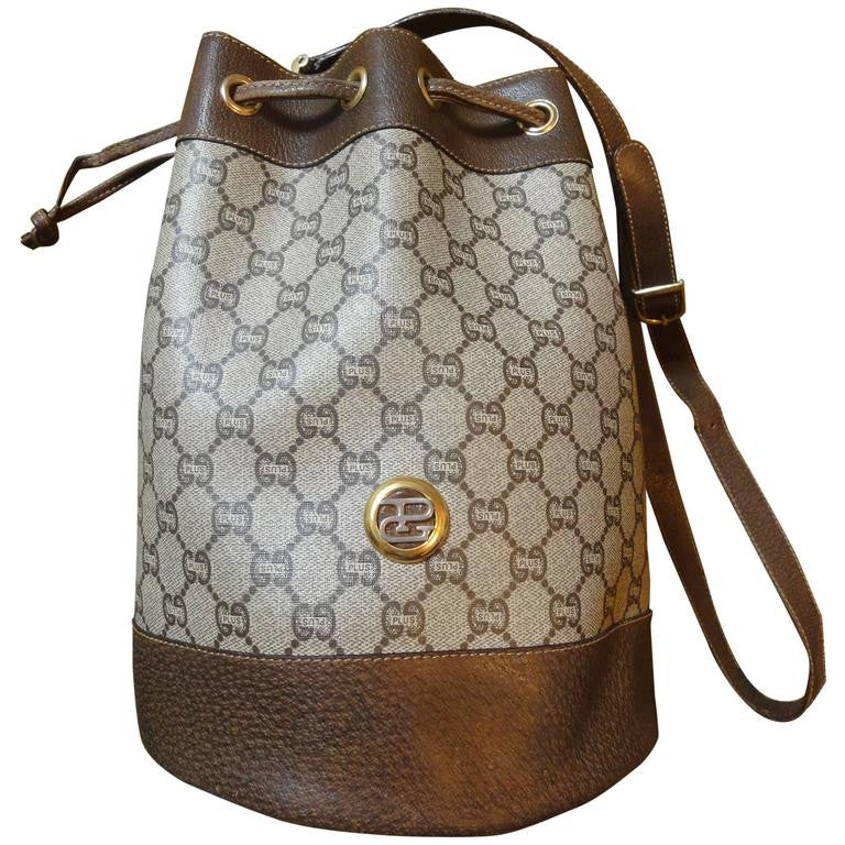 Vintage Gucci Plus monogram and leather hobo bucket purse with draw strings. Great masterpiece for your another Gucci collection. riri zipper