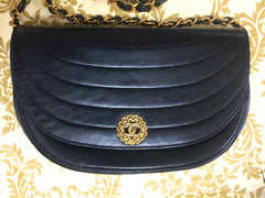 80's Chanel black lambskin half moon shape 2.55 shoulder bag with golden round flower CC motif closure. Rare masterpiece purse
