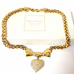 MINT. Vintage Nina RIcci golden chain statement necklace with ribbon bow and crystal stone heart pendant top. Perfect vintage jewelry