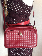 Vintage Celine wine red genuine leather camera bag style shoulder purse with golden logo motif and charms. Featuring quilted front.