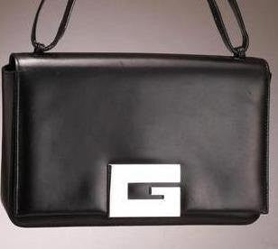 SOLD OUT: SALE Vintage Gucci black leather purse with a large G mark metal charm.