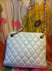 Vintage CHANEL quilted lambskin White tote with Gold-tone chain handles. Best for the season.