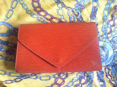 SOLD OUT: Vintage Louis Vuitton epi envelop style clutch with LV embossed. Trapezoidal shape
