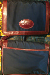 Vintage Longchamp navy nylon and red leather trimming shoulder purse. Original zipper