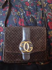 SOLD OUT: 80s vintage Gucci brown suede purse with monogram. Rare golden GG hardware. Very rare gucci vintage.