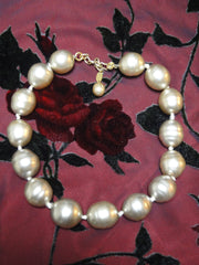 Vintage CHANEL extra large faux baroque pearl necklace. Get a chic and modern CHANEL look.