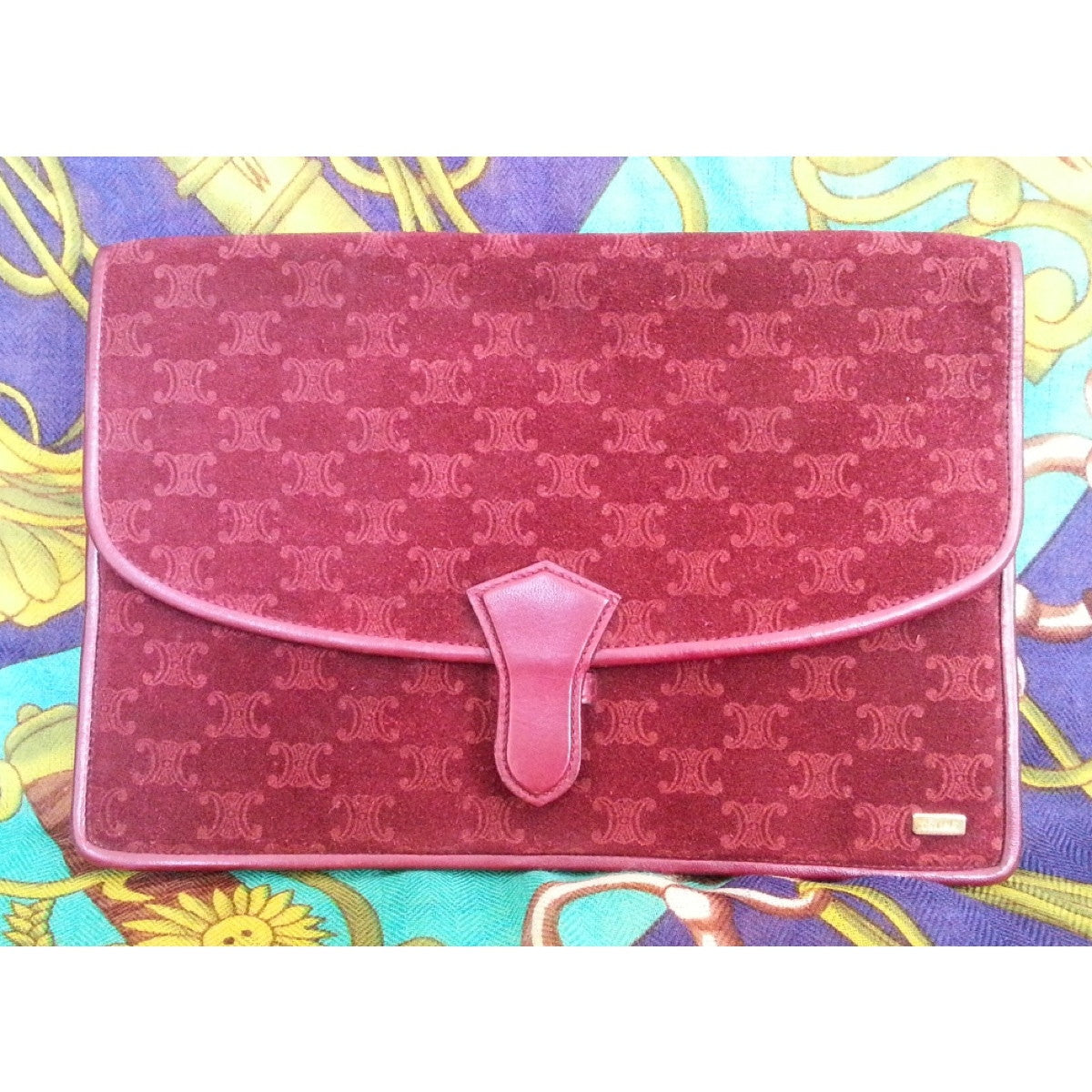SOLD OUT: 80s vintage Celine clutch purse in wine suede leather with iconic logo print all over. Rare and sophisticated vintage from Celine.