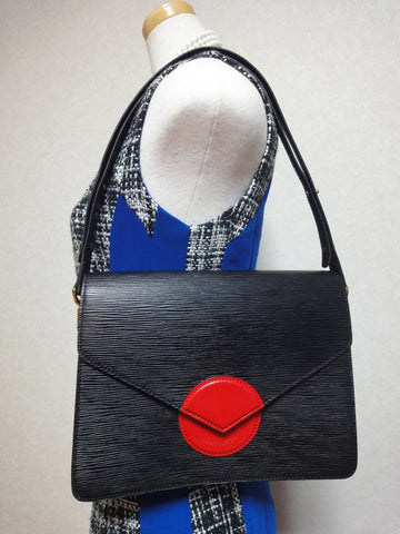 SOLD OUT: Vintage Louis Vuitton rare epi mod purse with red circle beak flap. very chic and mod