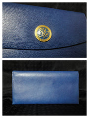 SOLD OUT: Vintage Christian Aujard blue leather wallet with golden motif at front. Almost MINT condition. Great gift.