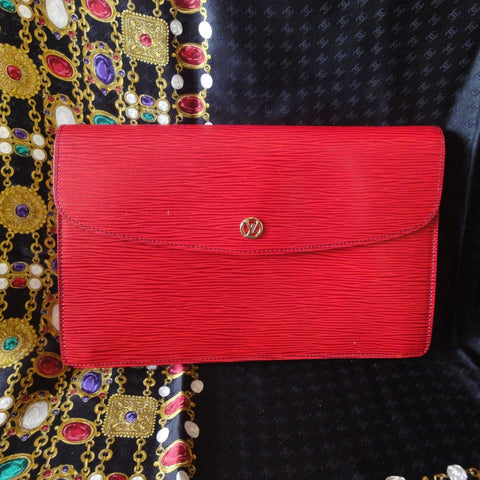 SOLD OUT: 80s Vintage Louis Vuitton red epi envelop style clutch with gold tone LV motif. Stunning red color that gives you the LOOK.