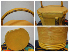SOLD OUT: Vintage Louis Vuitton yellow epi vanity purse in lovely cylinder shape. Happy color of yellow. Spring bag.
