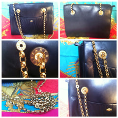 Vintage Tiffany and Company black elegant leather purse with golden chain straps and logo charms. Perfect bag for Tiffany fans.