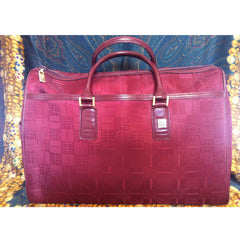 Vintage Givenchy travel duffle bag in classic monogram jacquard wine color with a logo pull and a golden charm. Unisex use large purse.