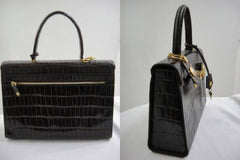 SOLD OUT: Vintage Gianni Versace dark brown croc embossed leather Kelly style bag with Medallion Sunburst charms . Gorgeous masterpiece