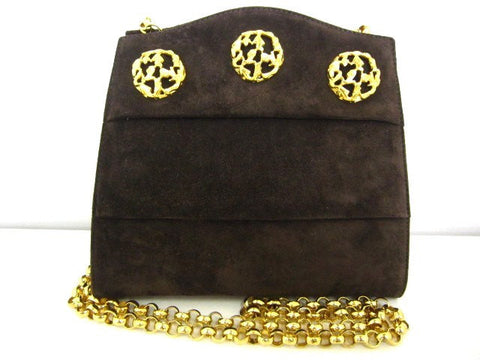 Vintage Salvatore Ferragamo dark brown suede leather party purse with golden decorative shoe motif charms and chain. Unique shape.