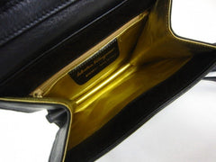 SOLD OUT: Vintage Salvatore Ferragamo black lamb leather purse with golden charm and fringe. golden interior
