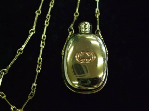 SOLD OUT: Vintage Gucci golden perfume bottle necklace with logo mark on top. Gorgeous rare masterpiece from 80s.