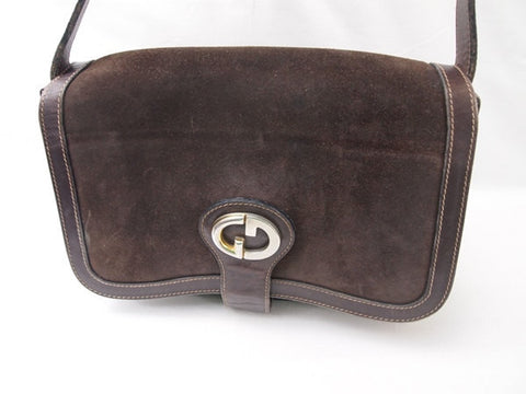 SOLD OUT: 80s Vintage Gucci darkbrown suede leather shoulder purse with iconic GG charm. Rare unique shape Gucci bag for unisex use. TALON zipper