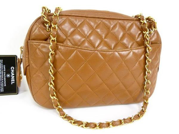 SOLD OUT: 80s Vintage CHANEL tanned brown lambskin size classic purse with double gold tone chain straps and a CC pull charm.