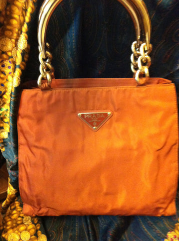 SOLD OUT: 90s Vintage PRADA nylon orange tote with gold tone metallic hardware handles and chains.