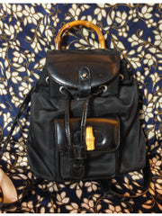 SOLD OUT: Vintage Gucci black enamel leather and nyloncombination backpack from bamboo collection. Sophisticated casual backpack