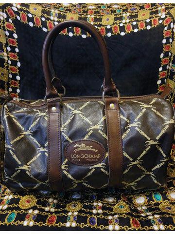 Vintage Longchamp a rare 80's darkbrown nappa leather duffle purse with logo prints all over. very classic for unisex