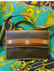 Vintage Celine traditional macadam blaison pattern shoulder purse with gold tone coin motif charms. Very rare piece from CELINE
