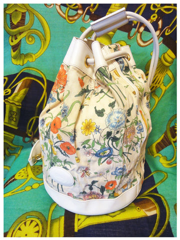 SOLD OUT: Vintage Gucci ivory canvas hobo bucket bag with muticolor flower prints and leather trimmings. A great piece from Accornero collection.