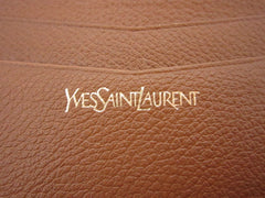 SOLD OUT: Vintage Yves Saint Laurent brown leather wallet with golden tone triangle logo motif on flap