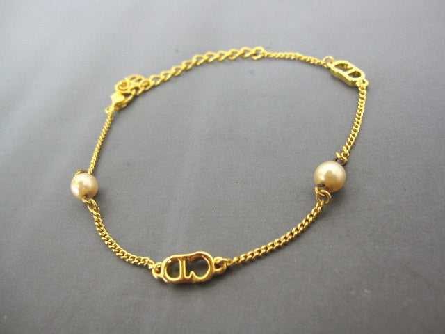 SOLD OUT: Christian Dior vintage faux pearl and gold tone skinny chain bracelet with CD charm. Best Gift